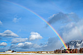 Rainbow over the church of Flakstad, Flakstad, Lofoten, Nordland, Norway