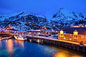 Illuminated fishermen's houses in the port of Nusfjord, Nusfjord, Lofoten, Nordland, Norway