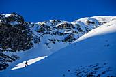Woman on ski tour climbs to the Wetterkreuzkogel, Wetterkreuzkogel, Stubai Alps, Tyrol, Austria
