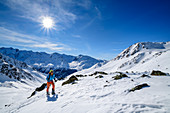 Woman on ski tour climbs to Hennesiglkopf, Langtauferer Tal, Ötztal Alps, South Tyrol, Italy