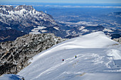 Two people on a ski tour descend a snow flank, Untersberg in the background, Hohes Brett, Berchtesgaden National Park, Berchtesgaden Alps, Upper Bavaria, Bavaria, Germany