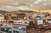 View over the city rooftops during sunset in Barcelona, Spain