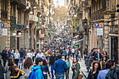 Lots of people in the Gothic Quarter in Barcelona, Spain