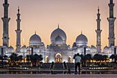 Photographer in front of the Sheikh Zayed Mosque in Abu Dhabi, UAE