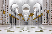 Beautiful columns with elaborate decorations in the Sheikh Zayed Mosque in Abu Dhabi, UAE