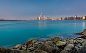 Evening view of the illuminated Abu Dhabi skyline, UAE