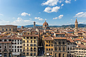 View over the city rooftops and the Duomo in Florence, Italy