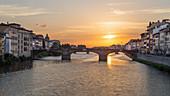 Sunset overlooking the Ponte Santa Trinita in Florence, Italy