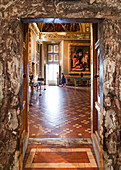 Tourists admire the artworks at the Pitti Palace in Florence, Italy