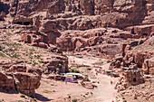 View of tourists walking through the ruins of the ancient Nabataean city of Petra, Petra, Jordan
