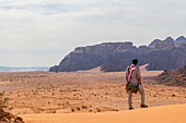 Traveler looks into the vastness of Wadi Rum in Jordan