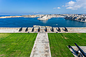 View from the Barrakka Gardens to the cannons and the fortress, Valletta, Malta