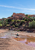 Berber rides in front of the old city of Ait Ben Haddou, Morocco