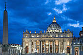 Front view of the illuminated St. Peter's Basilica in Rome, Italy