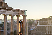 Camera photographs the Roman Forum during the sunrise in Rome, Italy