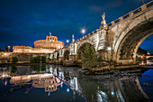 View of the Angel Bridge and Castel Sant'Angelo shortly after sunset at the blue hour, Rome, Italy