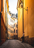 Tourist in the alleys of Gamla Stan in Stockholm, Sweden