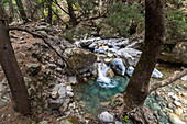 River course with turquoise clear water on the Samaria Gorge hike, West Crete, Greece
