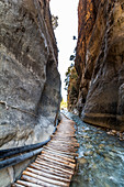 Wooden footbridge over river in Samaria Gorge, West Crete, Greece