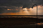 Light shower on the North Sea beach, Dorum, Lower Saxony, Germany