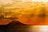 View of the Stromboli volcano with the sea in the foreground