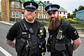 Friendly bearded police officers are ready to answer tourists' questions and remind them of UK road traffic regulations, Stanley, Falkland Islands, British Overseas Territory