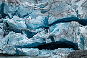 Detail of the front of the massive glacier with cracks and narrow caves, Pio XI Glacier, Magallanes y de la Antartica Chilena, Patagonia, Chile, South America