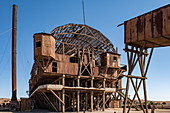The skeletal remains of the Humberstone and Santa Laura saltpeter processing plant are rusting in the dry desert landscape, near Iquique, Tarapaca, Chile, South America
