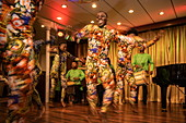 Local dancers appear in colorful costumes during a folklore performance in the lounge of the expedition cruise ship MS Bremen (Hapag-Lloyd Cruises), Manta, Manabi, Ecuador, South America