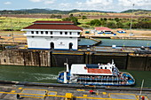 A tour boat pulls into one of the Miraflores locks on the Panama Canal, near Panama City, Panama, Central America