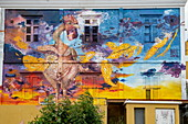 An amusing, colorful mural with a plucked rooster decorates this building in downtown Willemstad, Curaçao, Netherlands Antilles, Caribbean