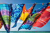 Used for beachwear, colorful, transparent fabric segments hang from a clothesline, ready for sale, Pigeon Point, Tobago, Trinidad and Tobago, Caribbean