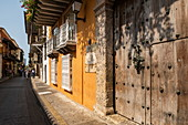 One of the many narrow streets that run through the picturesque and historic colonial old town, Cartagena, Bolivar, Colombia, South America