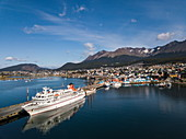 Aerial view of the expedition cruise ship MS Bremen (Hapag-Lloyd Cruises) along the pier in front of the SS Europa, Ushuaia, Tierra del Fuego, Patagonia, Argentina, South America