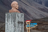 A bust of Lenin stands near the community center in the former mining town of Pyramiden, Billefjord, Spitsbergen, Norway, Europe