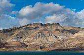 Centuries of erosion have created fascinating patterns and structures on the slopes of these rugged mountains, Billefjord, Spitsbergen, Norway, Europe