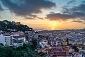Sunset at Miradouro da Graca with a view of Castello de Sao Jorge, Ponte 25 de Abril and the Tagus, Lisbon, Portugal