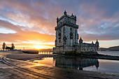 The Torre de Belem during sunrise is one of the symbols of the golden era of the Portuguese, Lisbon, Portugal