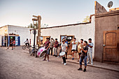 Street musicians in the dusty streets of San Pedro de Atacama, Atacama Desert, Antofagasta Region, Chile, South America