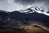 View to the cloud-covered summit of the Osorno volcano, Region de los Lagos, Chile, South America