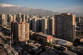 View of apartment blocks and surrounding mountains of the capital city Santiago de Chile, Chile, South America