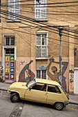 Street art and old car on a steep street in Valparaiso, Chile, South America