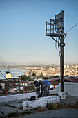 local group of men enjoys the view of Valparaiso, Chile, South America