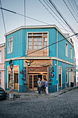 """Guests smoke in front of the """"Hotzenplotz"""" pub, Valparaiso, Chile, South America"""