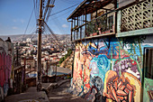 Street art in the streets of Valparaiso, view to the port, Chile, South America