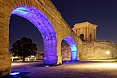 France, Herault, Montpellier, Saint Clement Aqueduct lighting by the artist Yann Kersale and water tower