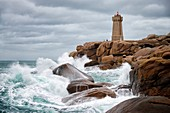 France, Cotes d'Armor, cote de Granit Rose (Pink Granite Coast), Perros Guirec, Ploumanac'h, la pointe de Squewel (Squeouel) and the lighthouse of Mean Ruz (Men Ruz) during storm