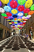 """France, Bouches du Rhone, Arles, Jean Jaures street, installation of Patricia Cunha """"Colorful Umbrellas"""" (Compulsory Mention)"""