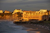 France, Pyrenees Atlantiques, Basque Country, Biarritz, view of the Big Beach and the Palace Hotel or Eugenie Villa at sunset