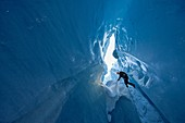 France, Haute-Savoie, Chamonix, abselling in the Moulin de la Mer de Glace, crevasse where water flow